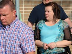 Kimberly Saenz is escorted Friday from the courthouse in Lufkin, Texas, after she was convicted of killing dialysis patients at a clinic.