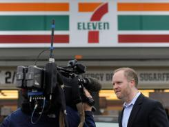 Stephen Martino, director of the Maryland Lottery, speaks to reporters Saturday outside a Baltimore 7-Eleven store where one of the winning lottery tickets for the record-breaking Mega Millions jackpot was sold.