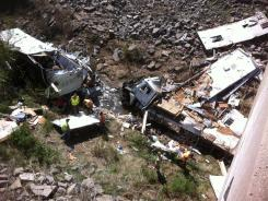 A Minnesota-bound motor home was carrying 18 people and pulling a trailer when the driver lost control and crashed into a Kansas ravine, police said.
