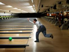 Republican presidential candidate Rick Santorum bowls at Sabre Lanes after a campaign rally April 2 in Menasha, Wis.