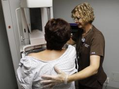 Roxanne Gross performs a mammogram on a patient at the David Geffen School of Medicine at UCLA.