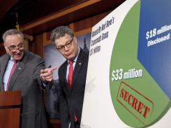 Sen. Charles Schumer, D-NY, left, and Sen. Al Franken speak during a news conference in Washington in February to discuss the disclosure of Super PAC donors to Republican presidential candidates.