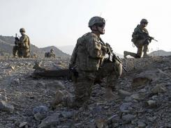 U.S. troops observe a joint patrol of U.S. and Afghan soldiers in Paktika province, Afghanistan.