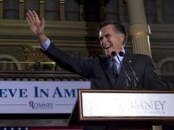 Mitt Romney waves to supporters at a primary night rally in Milwaukee on Tuesday.