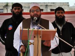 The bounty for Hafiz Saeed, center, was posted on the U.S. government's Rewards for Justice website.
