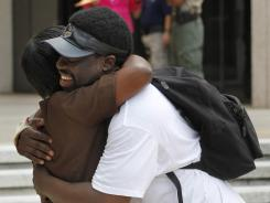 Supporters of victims and their families embrace after five former New Orleans police officers were convicted on Aug. 5 in the deadly shootings on a bridge after Hurricane Katrina.