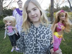 Jane Bingham of Mantua with her daughter Belleliana,9, who holds two of the dolls, Moxie and Barbie. Manufacturers have agreed to start making a bald friend as an inspiration to cancer patients like Jane who has non Hodgekins's lymphoma.