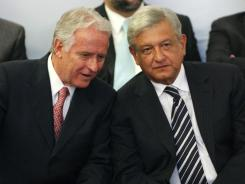 Andres Manuel Lopez Obrador, right, listens to Mexican businessman Alejandro Marti in Mexico City on Monday during an event hosted by the non-governmental organization Mexico SOS that advocates security and justice.