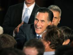 Mitt Romney greets supporters at a rally in Milwaukee Tuesday night following his wins in the Wisconsin, Maryland and District of Columbia primaries.