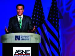 Mitt Romney speaks at the Newspapers Association of America/American Society of News Editors luncheon gathering in Washington on Wednesday.