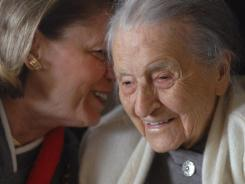 Dr. Leila Denmark, right, listens to her grand niece Jackie Bennett as she celebrates her 110th birthday, in Athens, Ga.