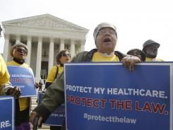 Outside the hearing: Supporters of the health care law rally at the Supreme Court on March 28.