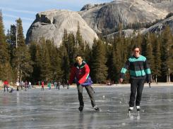 Keeler Johnston, 18, left, and Kirk Carlson, 17, skate along the frozen Tenaya Lake in Yosemite on Jan. 1.