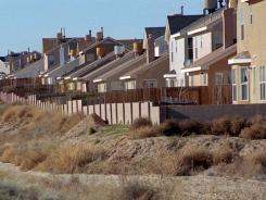 Communities within commuting distance larger cities such as Los Lunas, N.M., had been beneficiaries -- or victims -- of urban sprawl. New Census data show this trend is waning.