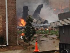 Navy jet crashes into Va, apartments, pilots eject