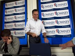 Mitt Romney gets ready to work the phones Thursday at a call center at his Pennsylvania campaign headquarters in Harrisburg, Pa.