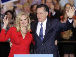 Mitt Romney and his wife, Ann, wave as they leave an election night rally in Schaumburg, Ill.