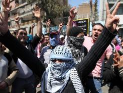 Protesters chant slogans against Syrian President Bashar Assad during a demonstration after Friday prayers in Beirut.