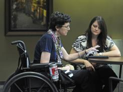 Judy Miles, left, works with therapist Lindsey Buguee during speech therapy Tuesday at Quality Living Inc. in Omaha, Neb.