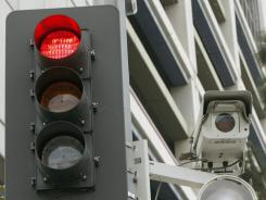 According to the Insurance Institute for Highway Safety, red-light cameras are used in about 555 communities around the USA.