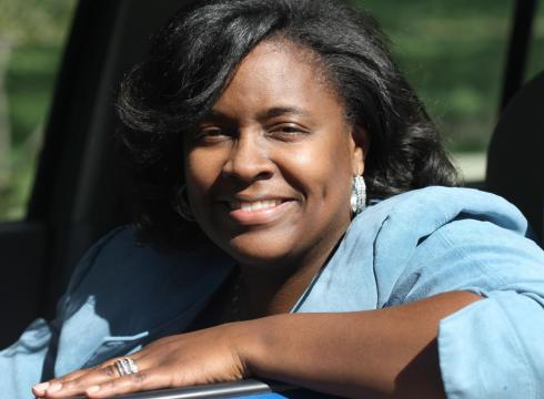 <b>Benita Jackson</b>, 41, of Detroit poses with her 2004 Saturn Vue she recently <b>...</b> - Ways-to-Work-drives-success-for-low-income-5G1904PN-x-large