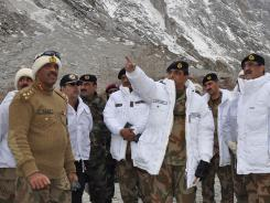 Pakistan's army chief ,Gen. Ashfaq Parvez Kayani, center, gestures during his visit to the site of an avalanche in Siachen.
