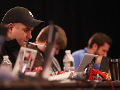 Gerry Brunelle, 25, helps challenge students at a cybersecurity competition March 16 in Laurel, Md.