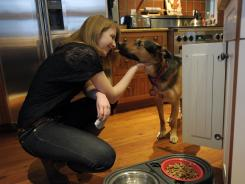 Kristen Powers feeds her rescue dog, Jake, before heading to school in Chapel Hill, N.C.