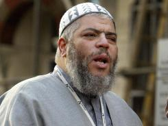 In 2003, radical Imam Abu Hamza al-Masri leads prayers on outside the closed Finsbury Park Mosque.