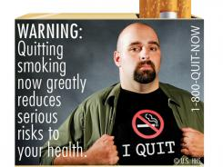 "The nine different warnings include a picture of a man wearing a t-shirt that says ""I quit."" the warning label states ""quitting smoking now greatly reduces serious risks to your health."""