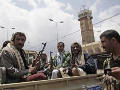 Yemen's main airport reopened on Sunday, a day after gunmen loyal to the former president seized the facility in Sanaa. An al-Qaeda branch has exploited the political turmoil.