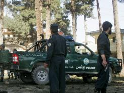 Bodies of victims are covered at the scene of a suicide attack in Guzara, Herat province, on Tuesday.