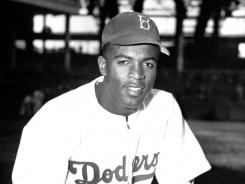 Robinson:  Broke the color barrier on April 15, 1947.