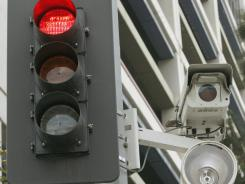 Here's looking at you: Red-light cameras are used in about 555 communities around the USA.