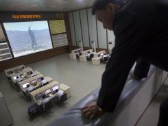 A man looks down from a balcony at North Korea's space agency's General Launch Command Center on the outskirts of Pyongyang on Wednesday.
