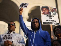 A rally forms on the steps of City Hall in Los Angeles after a silent march Monday to demand justice for the shooting death of Trayvon Martin.