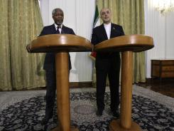 U.N.-Arab League envoy Kofi Annan, left, speaks during Wednesday's news conference with Iranian Foreign Minister Ali Akbar Salehi in Tehran, Iran.
