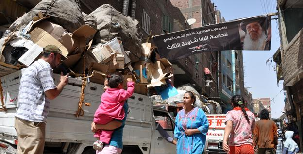 The streets of Garbage City, home to the Zabaleen, are packed with pedestrians and trucks moving recyclable goods.