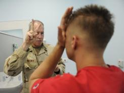 U.S. Navy Capt. Michael Wagner, a neurologist stationed in Kandahar, leads a soldier through an exam after the solider was exposed to an IED blast. In the early years of the Iraq and Afghanistan wars, troops were rarely pulled aside and examined for signs of a concussion after being exposed to a roadside blast.