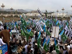 Supporters of Pakistani religious parties rally against government allowing NATO to resume shipping supplies through the country to its troops in neighboring Afghanistan.