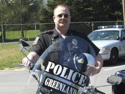 This undated photo provided by the Greenland Police Department shows Chief Michael Maloney.