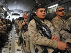 U.S. servicemembers sit inside a plane before their departure to Afghanistan from Manas, outside Kyrgyzstan's capital of Bishkek on March 27.