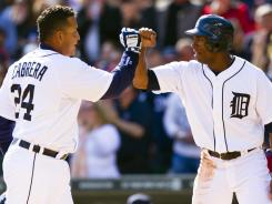 Detroit Tigers third baseman Miguel Cabrera (24) receives congratulations from center fielder Austin Jackson after hitting a home run at Comerica Park.