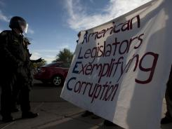 Occupy Phoenix protesters demonstrate against the American Legislative Exchange Council on Nov 30.