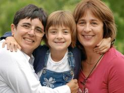 Giuseppina La Delfa, left, and Raphaelle Hoedts, right, with their daughter Lisa-Marie, in Rome, Italy. Italian residents La Delfa and Hoedts decided to have a baby but needed to go to Belgium for more than a dozen cycles of expensive IVF fertility treatment before La Delfa gave birth to daughter Lisa-Marie in 2003.