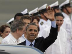 President Obama waves after arriving Friday in Cartagena, Colombia.