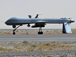 A U.S. Predator unmanned drone armed with a missile stands on the tarmac of Kandahar military airport in Afghanistan in 2010.