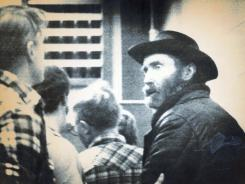 This 1984 image shows &quot;mountain man&quot; Don Nichols, right, being taken into custody near Bozeman, Mont.