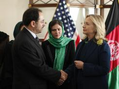 U.S. Secretary of State Hillary Rodham Clinton, front right, meets Salahuddin Rabbani at the U.S. Embassy in Kabul on Oct. 20.