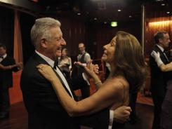 Passengers in evening dress dance during a reception on Friday aboard the MS Balmoral Titanic memorial cruise ship.